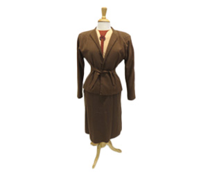 Chocolate brown woven wool suit. Suit jacket has shoulder pads and skirt has inverted pleats down the front.
