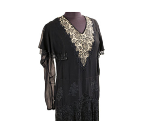 Black silk chiffon dress with lace applique on V neckline with nude under-lying fabric.
