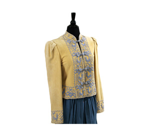 Tan jacket with ethnic blue embroidery with coordinating pants and skirt.