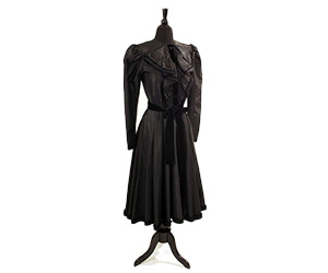 Givenchy dress in a black silk blend with velvet piping and a tied belt.