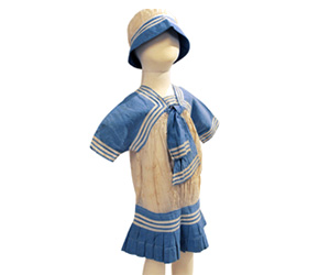 White and blue cotton children's sailor dress with matching cap.