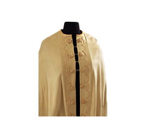 Tan wool cape with large buttons and passementerie detail.